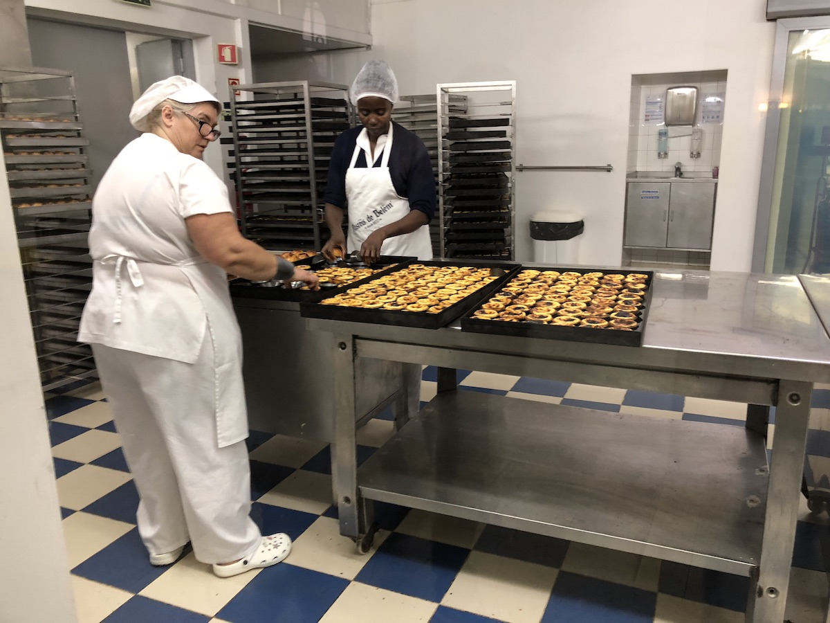 two bakers making pasteis de Belem