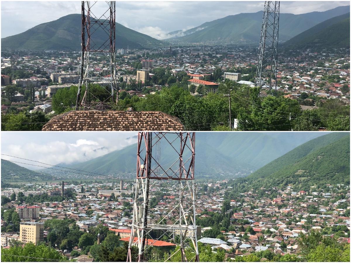 Sicht auf die Stadt von oben, mit zwei großen Antennenmästen dazwischen